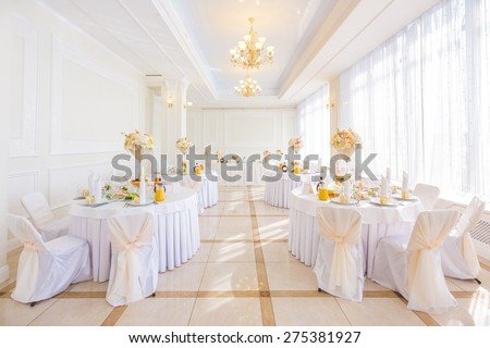 Decorated tables in restaurant - stock photo