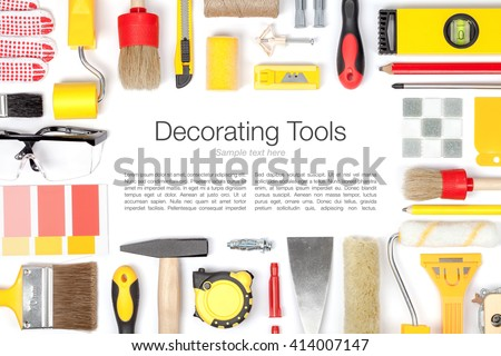 decorating and house renovation tools and accessories on white background. painter and decorator work table. flat lay frame composition in yellow and red colors with copy space top view - stock photo