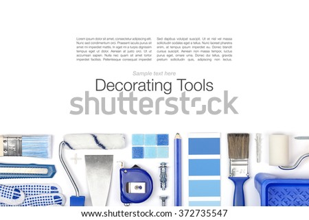 decorating and house renovation tools and accessories on white background with copy space. flat lay composition in blue colors top view - stock photo