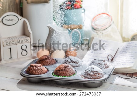 Decorating tasty cupcakes with caster sugar - stock photo