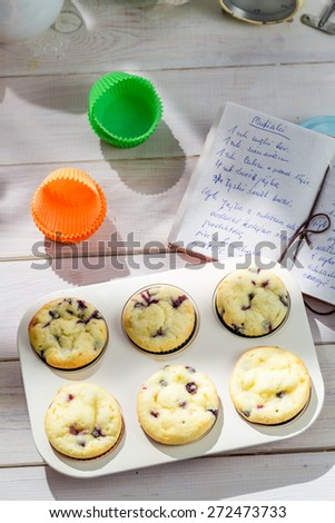 Decorating tasty muffins with cream and decoration - stock photo