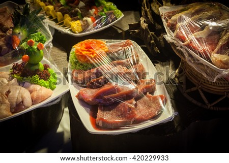 Decoration and raw foods that are wrapped with plastic wrap prepared for the wedding dinner party. - stock photo