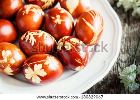 Decoration Easter Eggs with Fresh Leaves and Onions Peels - stock photo