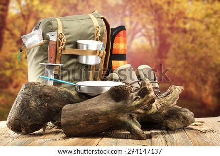 decoration of backpack and shoes and tree on table  - stock photo