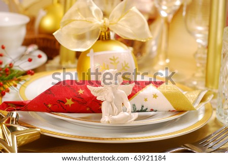 decoration of christmas table with angel in  white and golden colors - stock photo