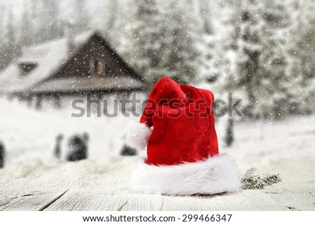 decoration of red hat and snow on table  - stock photo