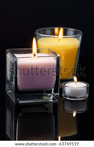 Decoration with burning candles on black - stock photo