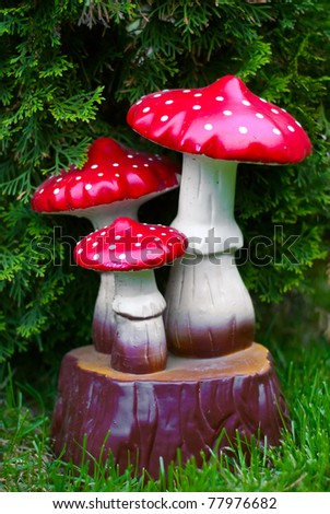 decorations for the garden mushrooms - stock photo