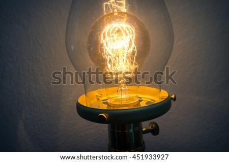 Decorative antique edison style filament light bulb - stock photo