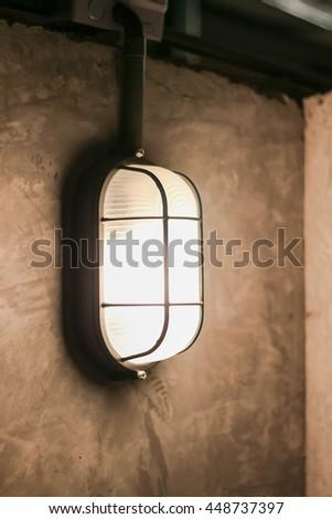 Decorative antique edison style filament light bulb outside at night - stock photo