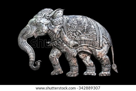 Decorative Art of Lanna Thai. silver carving art on temple wall . Srisuphan temple , Chiang mai, Thailand , (Public area) - stock photo