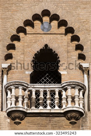 Decorative balcony of a  medieval tower in Seville, Spain - stock photo