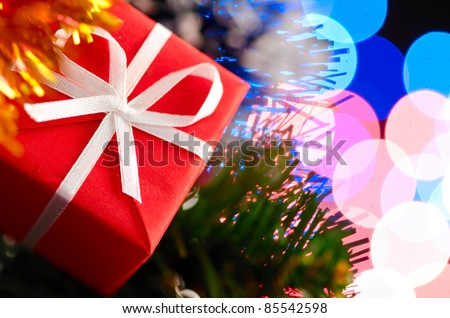 decorative ball on christmas tree with blurred lights on background. Shallow DoF - stock photo