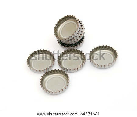 Decorative beer caps on white table - stock photo