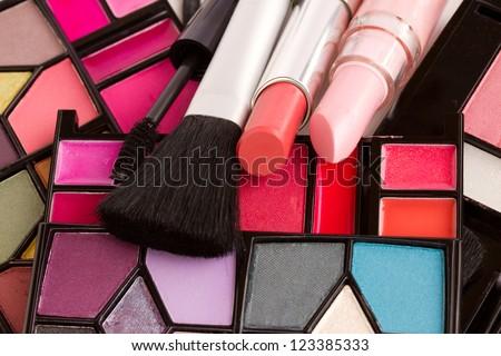 Decorative cosmetics  close up - eye shadows, lipsticks, mascara - stock photo