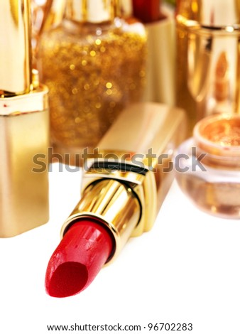 Decorative cosmetics with red lipstick. - stock photo