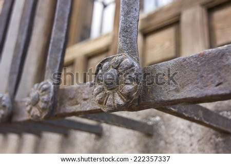decorative details in an old iron fence - stock photo