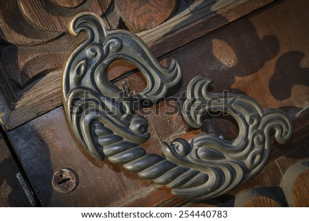 decorative door handle in the shape of a fish - stock photo