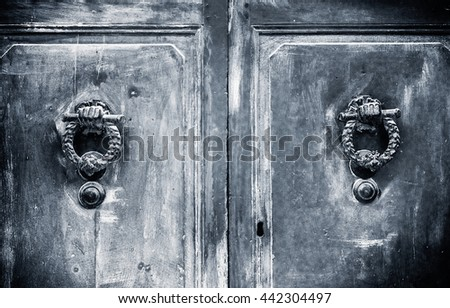 Decorative door knobs. Black and white photography. - stock photo