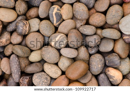 decorative floor pattern of a gravel stone - stock photo
