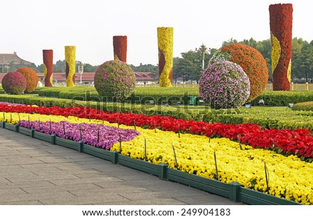 Decorative flower beds and shrubs on the periphery of Tiananmen Square in Beijing, China - stock photo