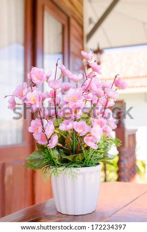 Decorative flower in the white vase - stock photo