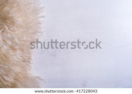 Decorative fur carpet on wood floor background - stock photo