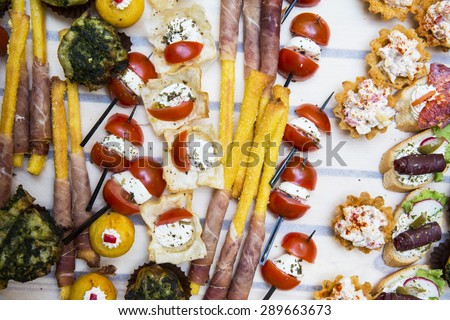 Decorative Garnished Modern Canapes Served at Party - stock photo