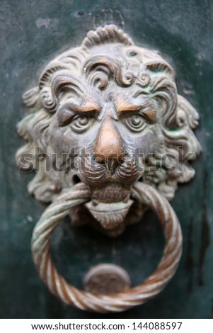 Decorative gilded lion head door knob - stock photo