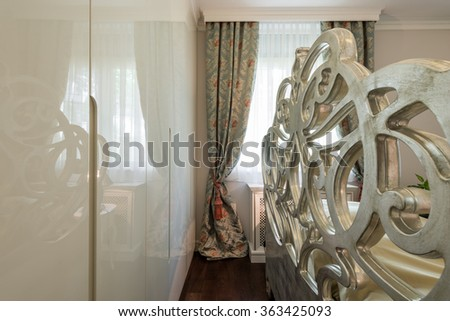 Decorative headboard and closet in the bedroom - stock photo