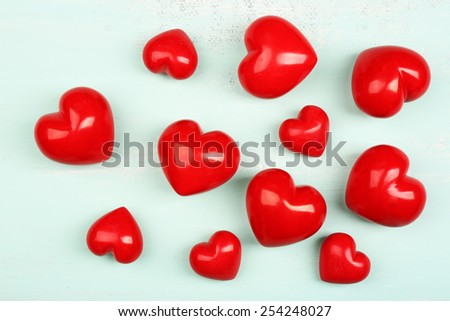Decorative hearts on wooden background - stock photo