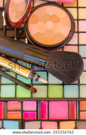 decorative make up cosmetics with powder and brushes - stock photo