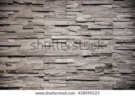 Decorative modern gray slate stone wall - stock photo