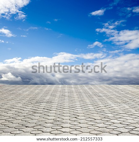 decorative paving stone on a background of blue sky - stock photo