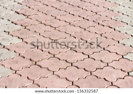 decorative paving stones of the road, background - stock photo