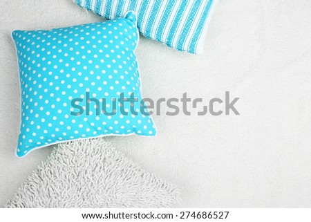 Decorative pillows on plaid close up - stock photo