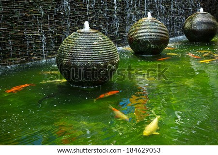 Fish fountain stock photos images pictures shutterstock for Decorative pond fish