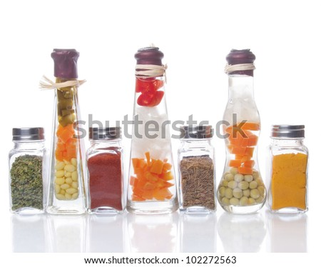 Decorative preserved vegetables and spice on the white background - stock photo