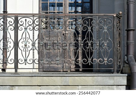 Decorative  railing  of the balcony, gallery in old  stiletto. Metal, wrought. - stock photo