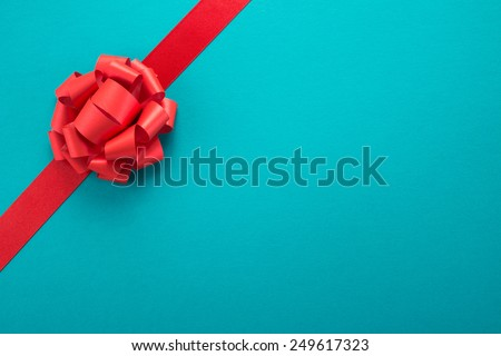 Decorative ribbon and bow on cardboard   - stock photo