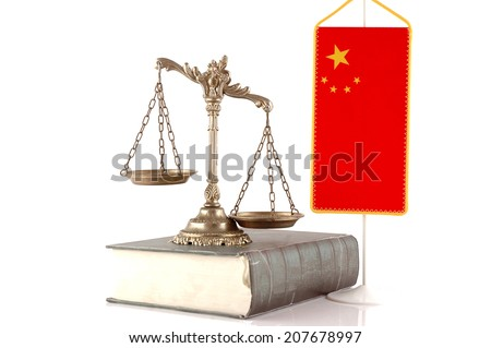 Decorative Scales of Justice on the book with Chinese flag on white. Law and order concept - stock photo