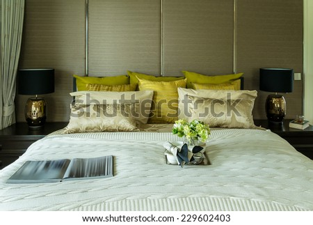 Decorative set with book,tea set and glasses on the bed - stock photo