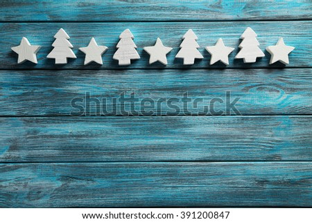 Decorative stars and fir-tree on a blue wooden background - stock photo