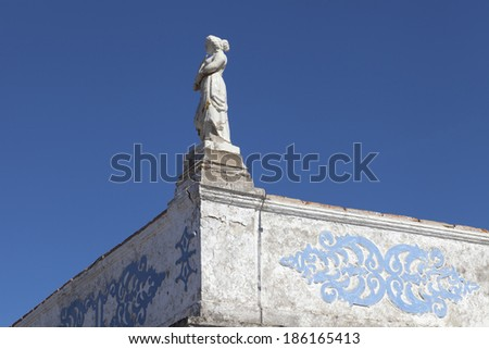 Decorative statue on the roof of a house in Alentejo, Portugal - stock photo