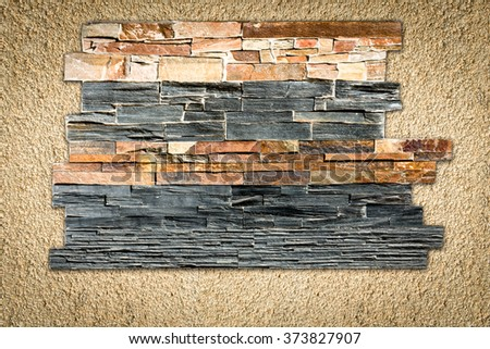 Decorative stones on the plastered wall - stock photo
