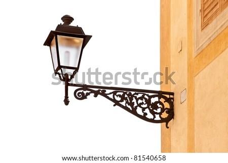 Decorative street lamp isolated on vhite background - stock photo