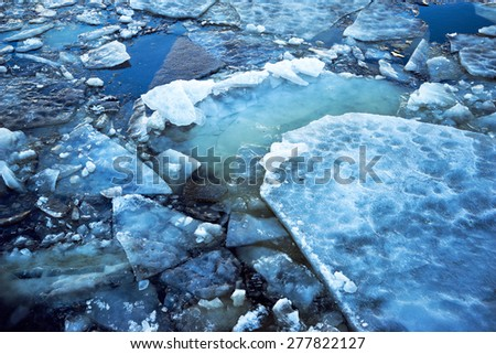 Decorative texture of ice in the river, spring time - stock photo
