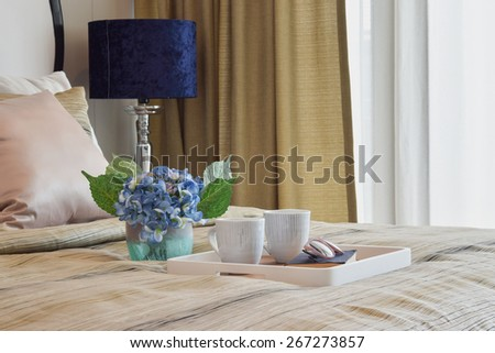 decorative tray of tea cup and book in stylish bedroom interior - stock photo