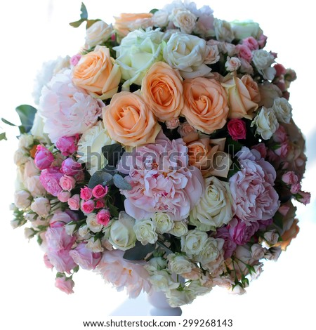 Decorative wedding nosegay of fresh beautiful flowers of roses and peony pink violet purple yellow lilac and orange colours in slim vase isolated on white background, square picture - stock photo