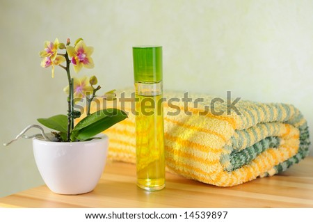 Decorative wellness set with orchid, perfume and towel - stock photo
